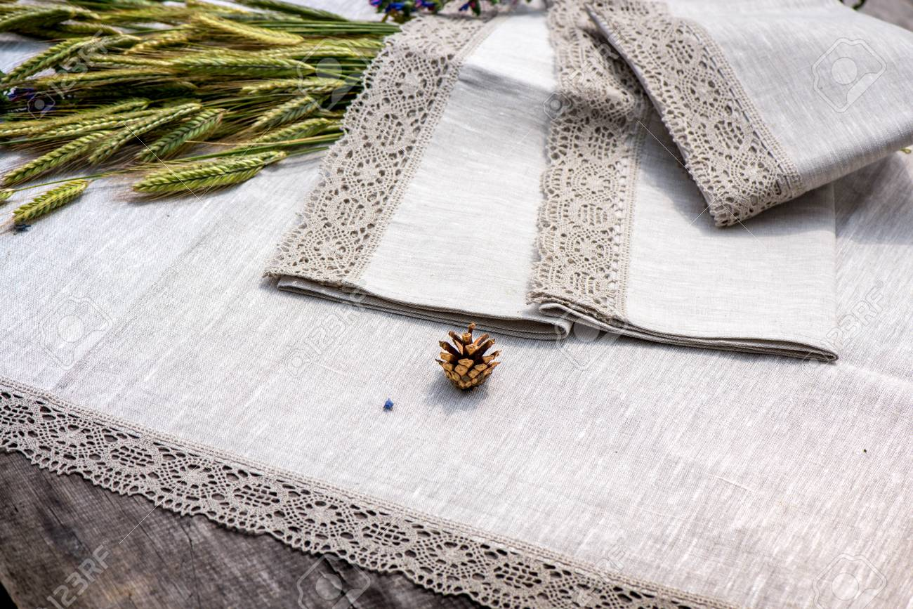 Shot Of Linen Tablecloths Towels And Napkins With Grey And White