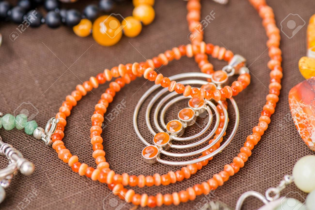 Serdolik (carnelian) Stone Necklace Laying On Natural Brown Linen Tablecloth.  Yashma, Orange