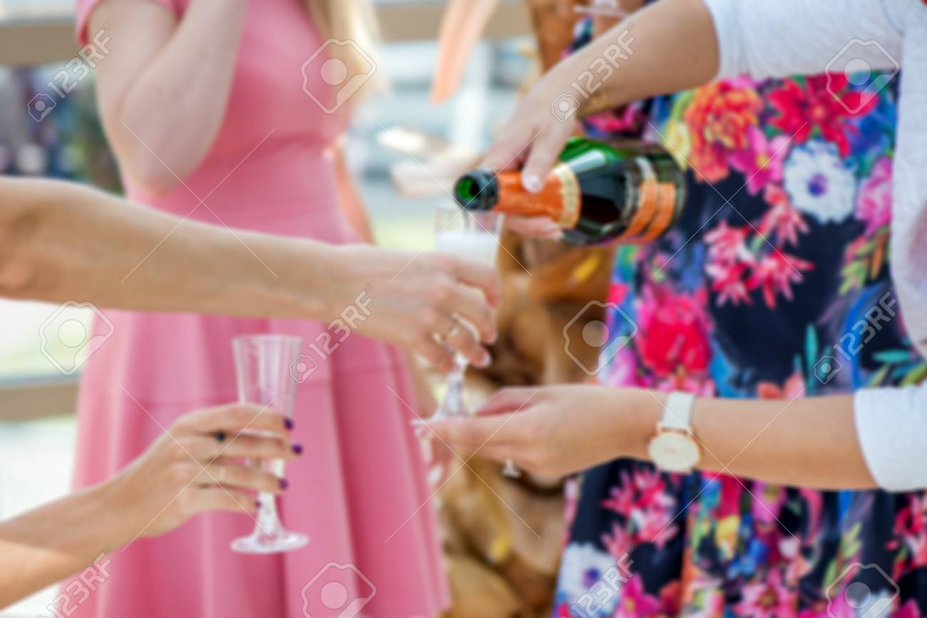 Group Of Girls In Pink Dress Code Celebrating - Pouring Champagne ...