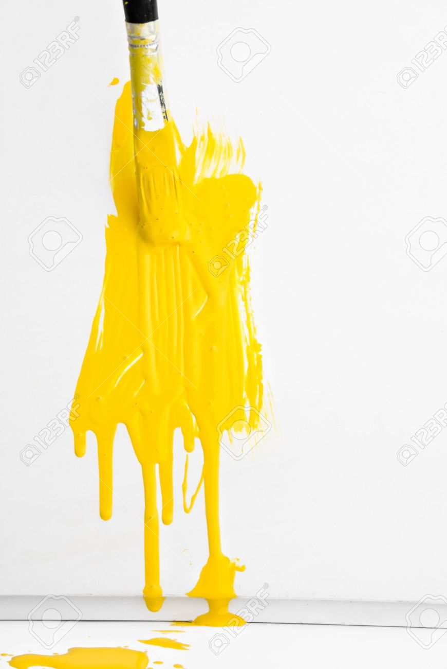 Yellow Paint Painting The Wall With Yellow Paint And Old Used Brush Stock Photo