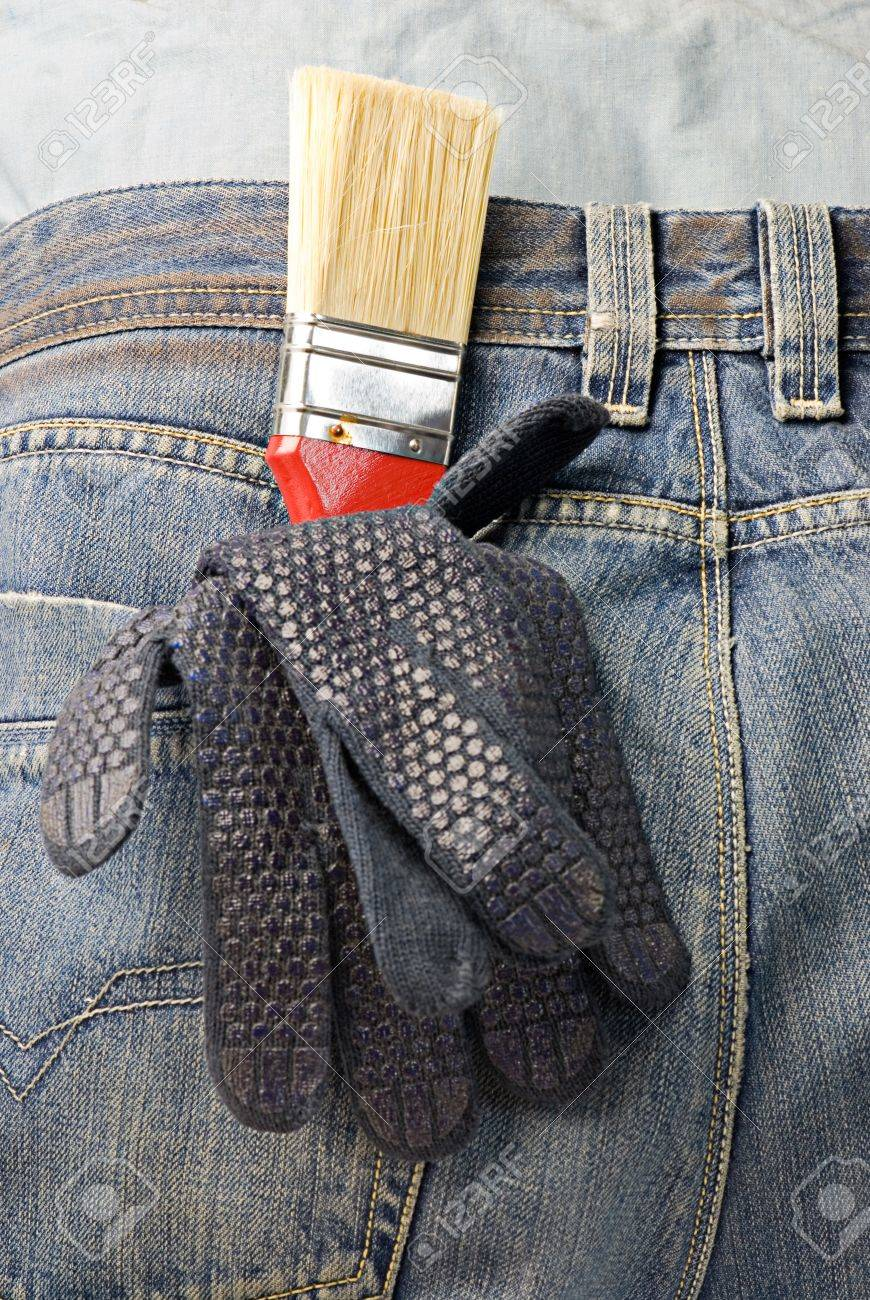 working gloves and brush in the back pocket of old used jeans Stock Photo - 7098006