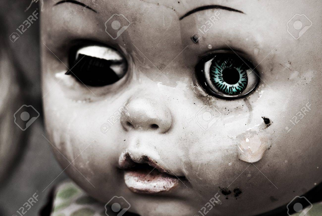 Concept: Abandoned Person. Close up of an old doll`s face with tear. Spesial grunge-fashioned image with grain Stock Photo - 7253006