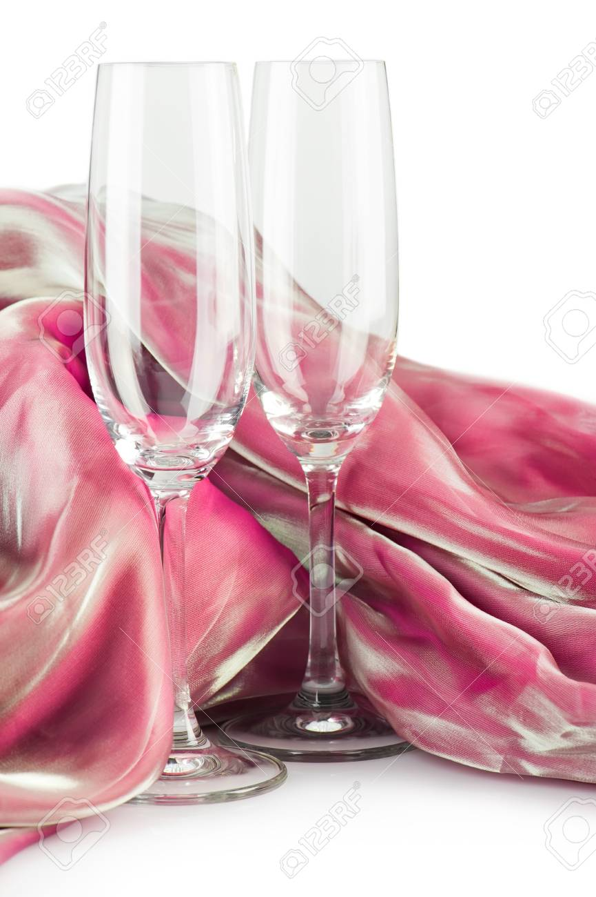 Party decoration. Two empty champagne glasses with silk decor over white Stock Photo - 9788748
