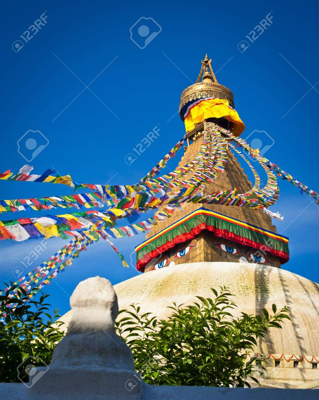 Buddhist Shrine Boudhanath Stupa with pray flags over blue sky. Nepal, Kathmandu Stock Photo - 16164031