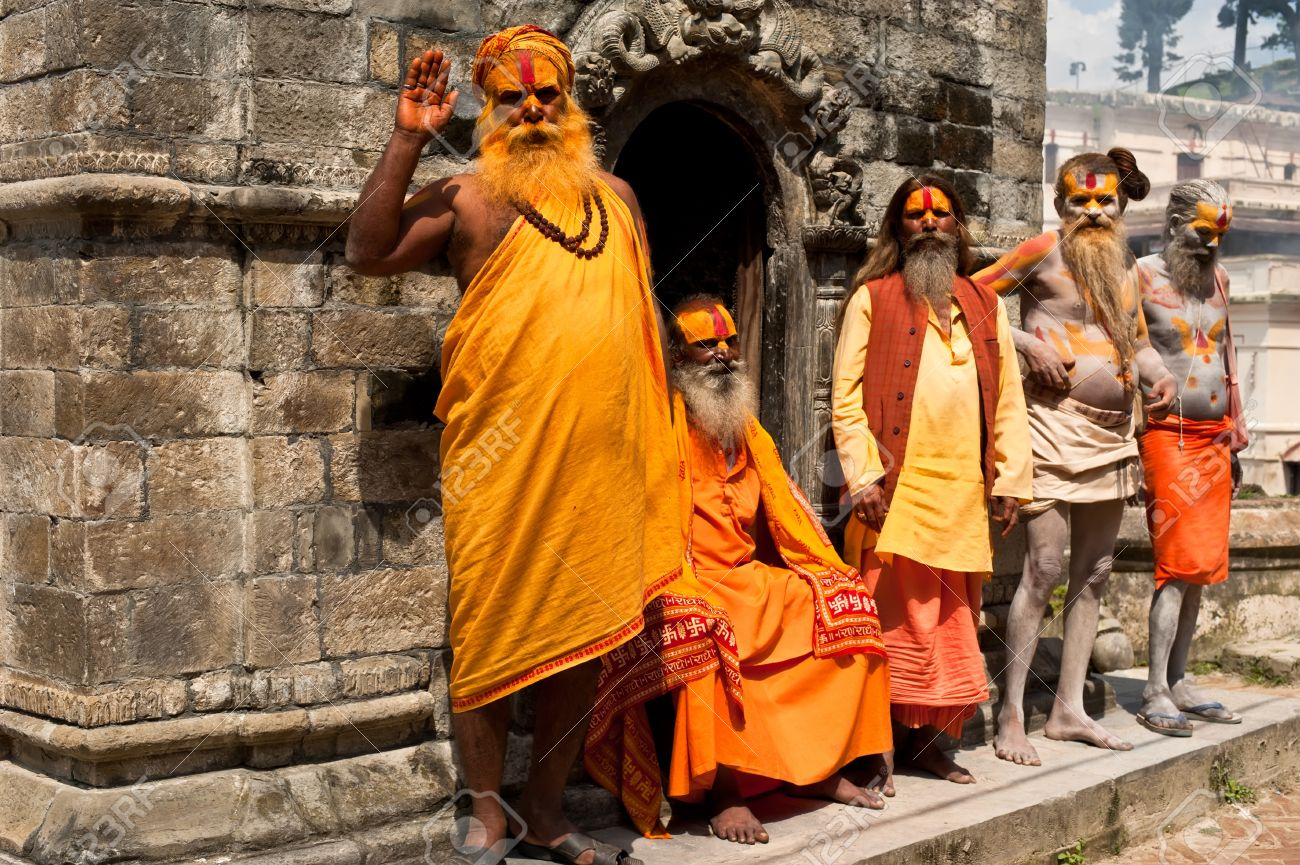 KATHMANDU, NEPAL, PASHUPATINATH TEMPLE - SEPTEMBER 21: Holy Sadhu men with traditional painted face, blessing in Pashupatinath Temple. Nepal, Kathmandu. September 21, 2012 Stock Photo - 16205975