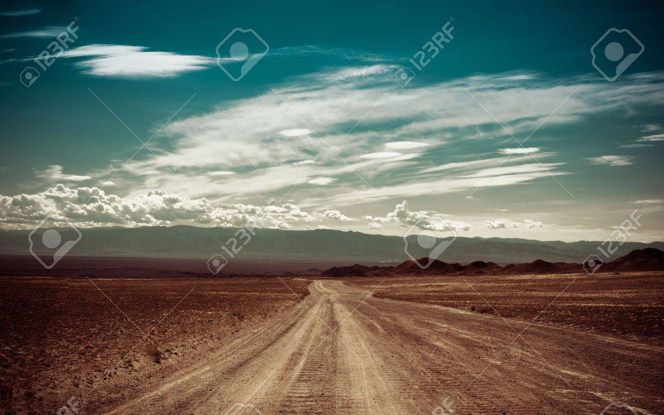 Empty rural road going through prairie under cloudy sky in Charyn canyon  State National Paleontology Park in Kazakhstan  Vintage style processing image Stock Photo - 21565963