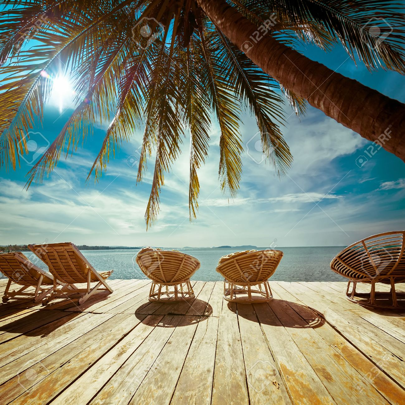 Amazing Tropical Beach Landscape With Palm Tree And Chairs For Relaxation On Wooden Terrace Travel
