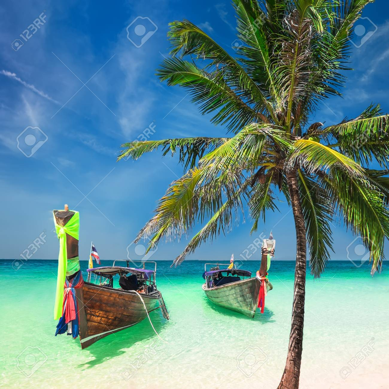Amazing Tropical Landscape With Thai Traditional Wooden Boats And Palm Tree At Ocean Beach Under Blue