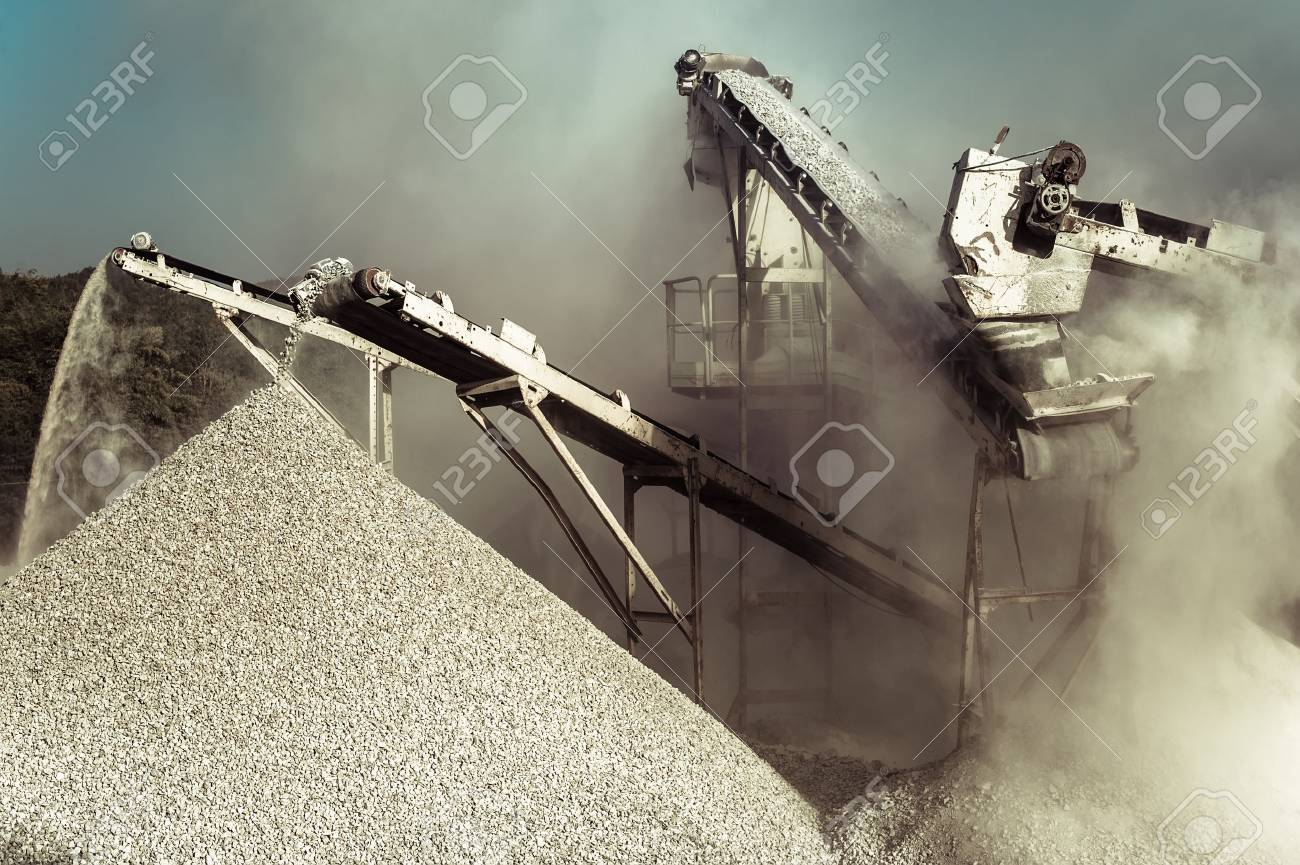 Industrial background with working gravel crusher - 53749906