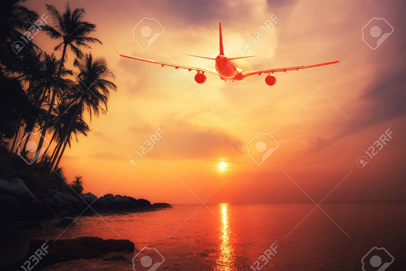 Airplane flying over amazing tropical sunset landscape. Thailand travel destinations - 53760084