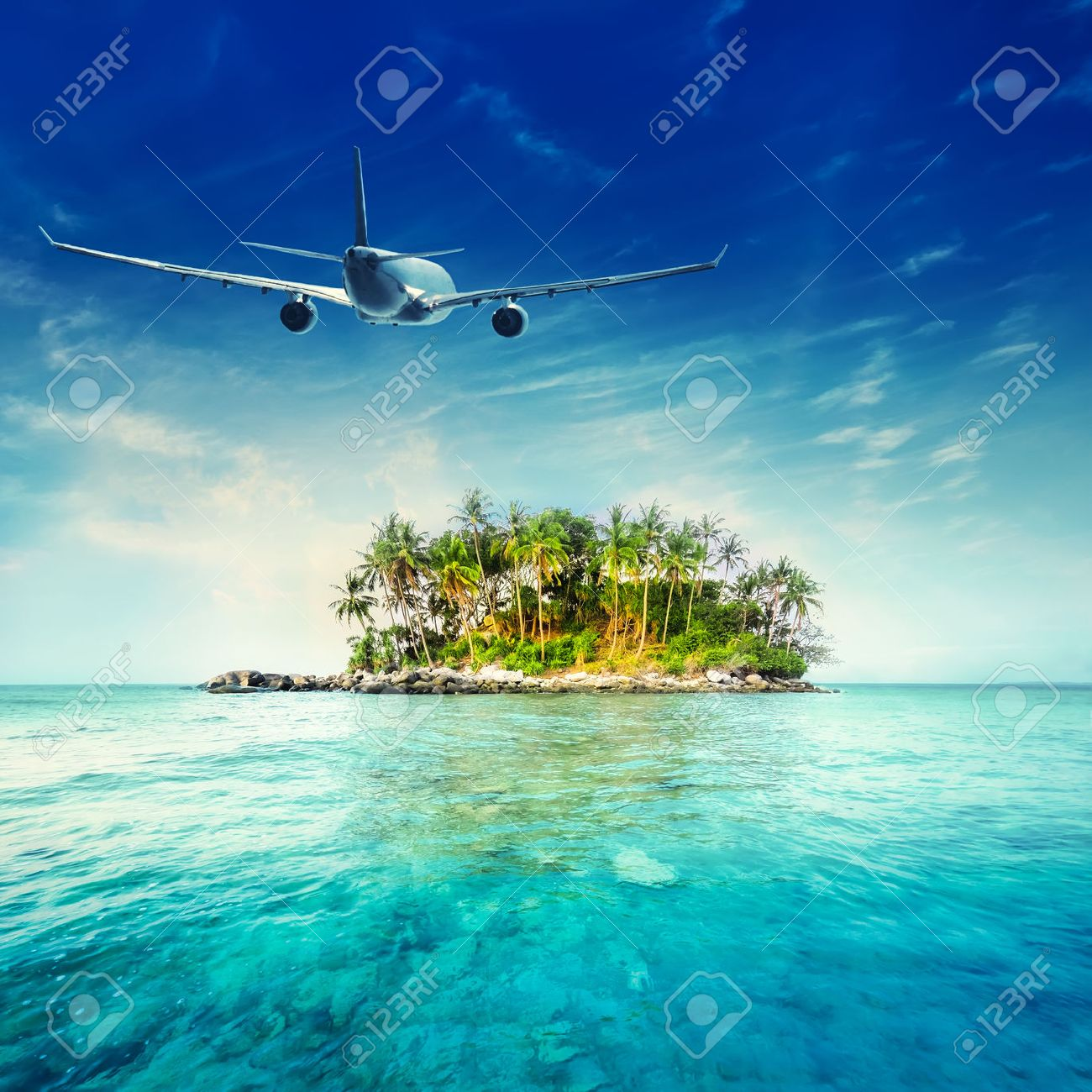 Airplane flying over amazing ocean landscape with tropical island. Thailand travel destinations - 53750178