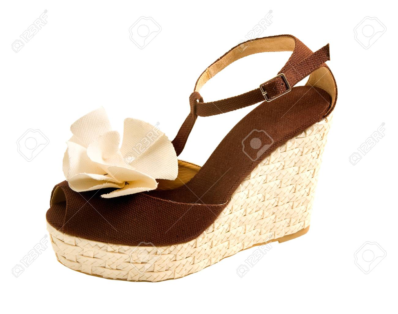 Wedge raffia peep toe sandal with fabric rose isolated on white background. Clipping path included. Stock Photo - 18608379