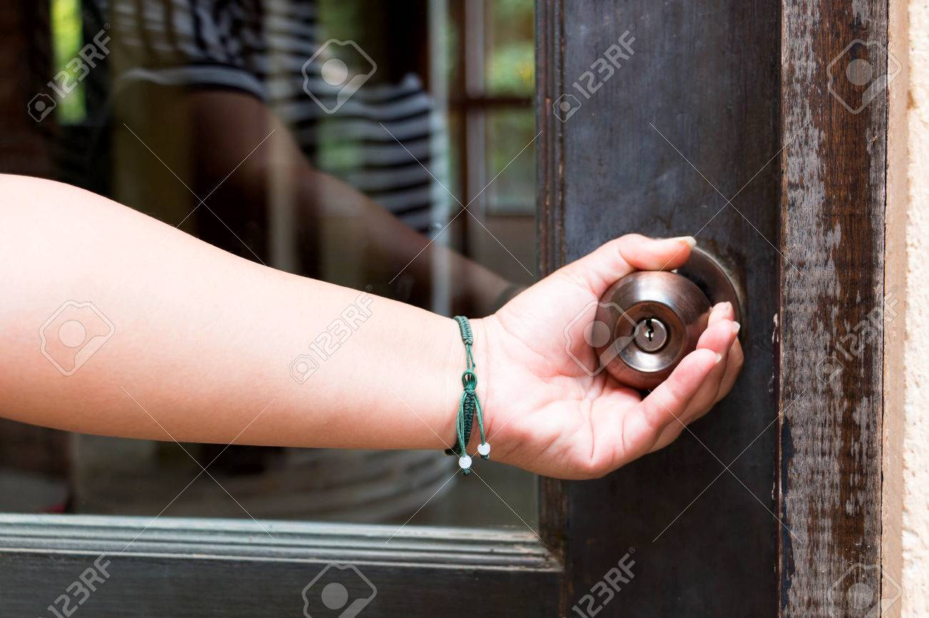 Stock Photo - woman hand holding doorknob represent opening or closing door & Woman Hand Holding Doorknob Represent Opening Or Closing Door Stock ...