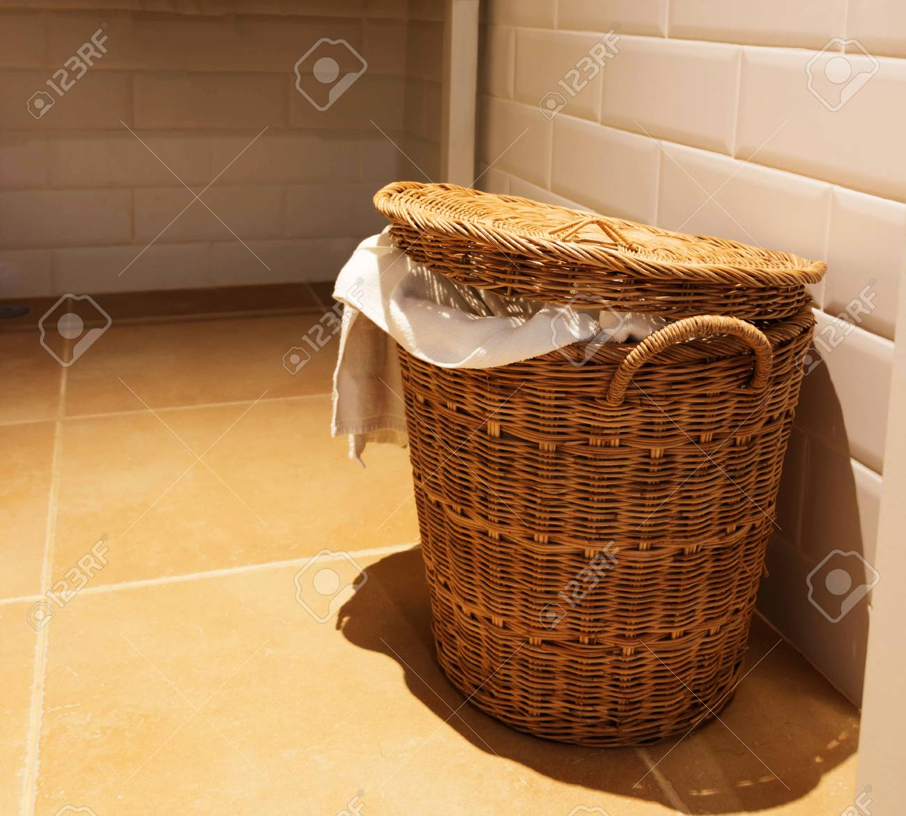 Used White Towel In Wooden Basket In Hotel Bathroom Stock Photo Picture And Royalty Free Image Image 99191677