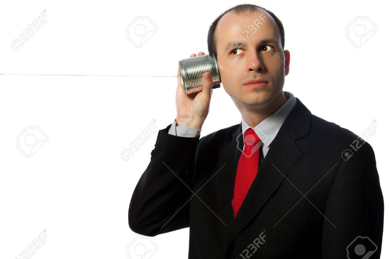 Man listening through an oldschool can phone, horizontal shot isolated on white Stock Photo - 13293710
