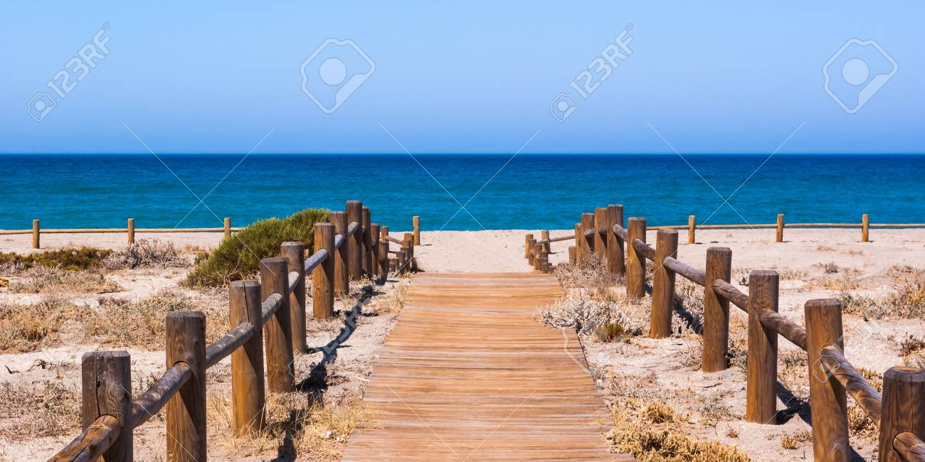 Wooden walkway to the beach in Almeria Spain - 106485461