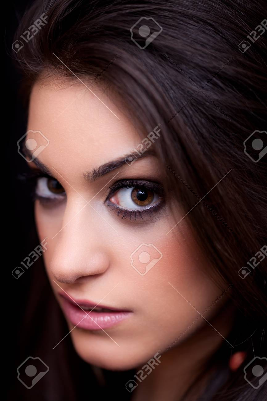 Portrait of a beautiful young woman, close up, on black background, studio shot Stock Photo - 9339650