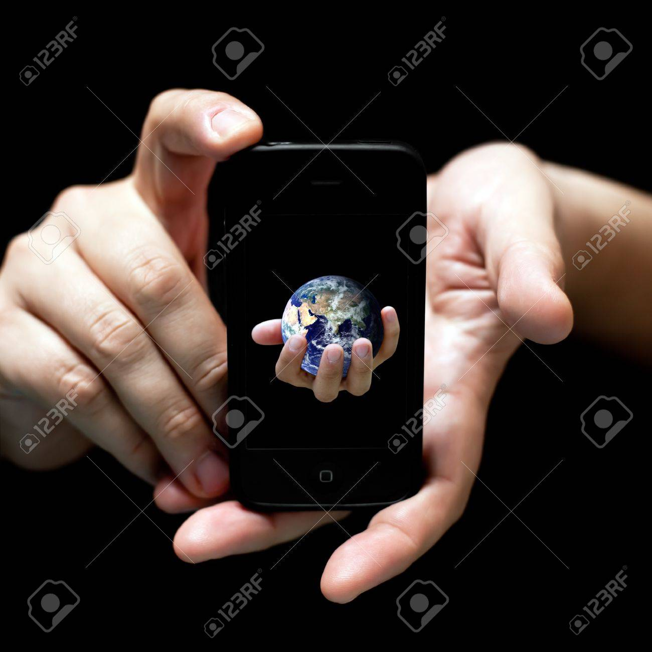 The world in your hands... smartphone (on black, very shallow depth of field) Stock Photo - 9862616