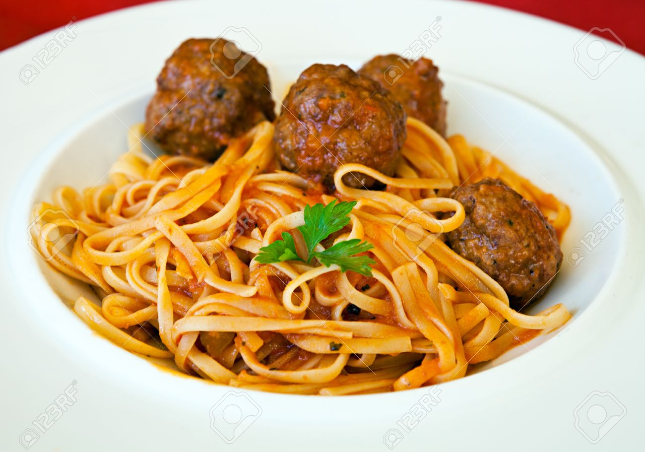 Italian food. Delicious pasta Linguine with meatballs and tomato sauce, served on a white plate.  Close up Stock Photo - 13419175