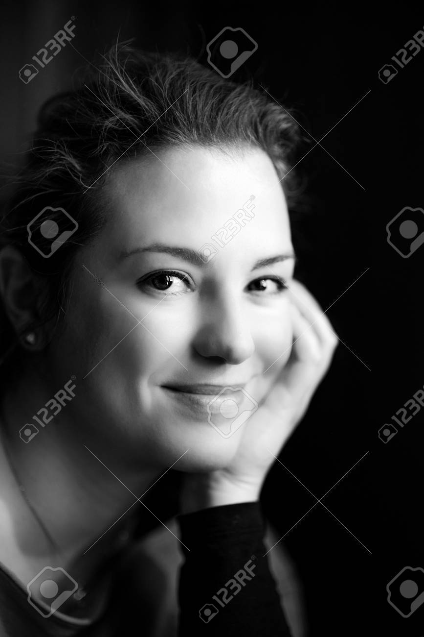 Classic beauty black and white portrait of a woman with natural window
