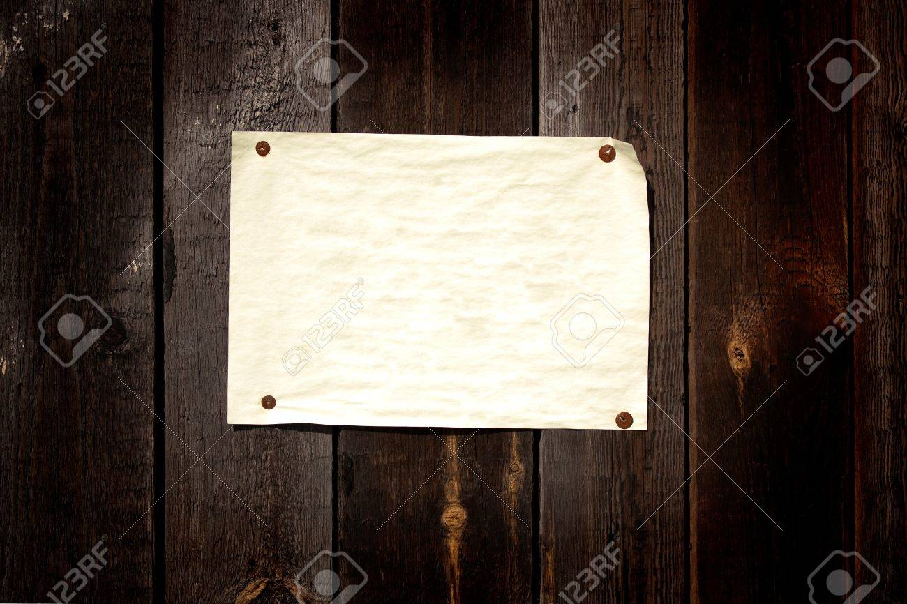 Old paper tacked to a wood wall Stock Photo - 7683616