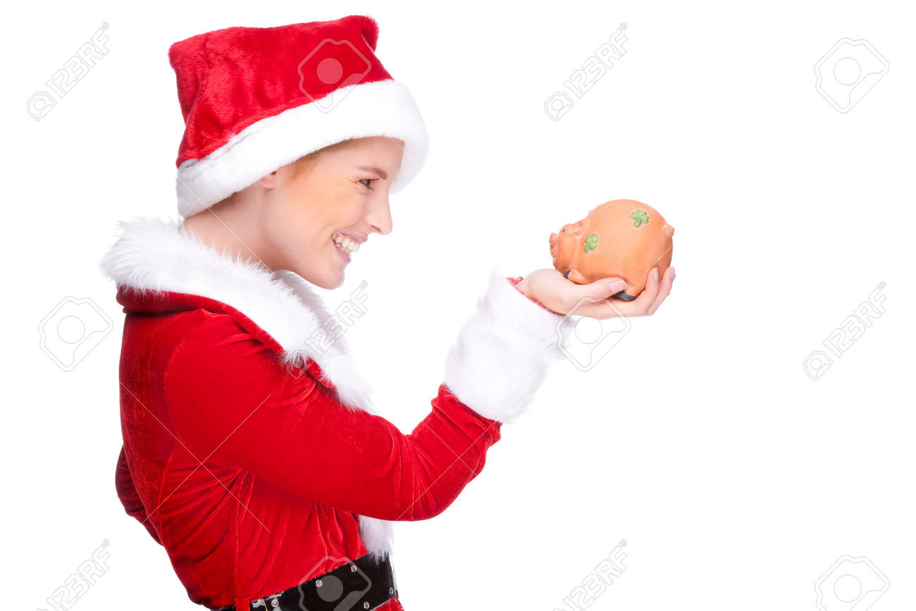 Full isolated studio picture from a beautiful woman in christmas dress with a piggybank Stock Photo - 10929383