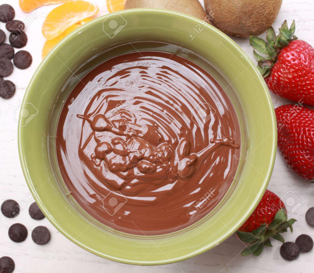 chocolate fondue kit and fresh fruit, beige background Stock Photo - 4900574