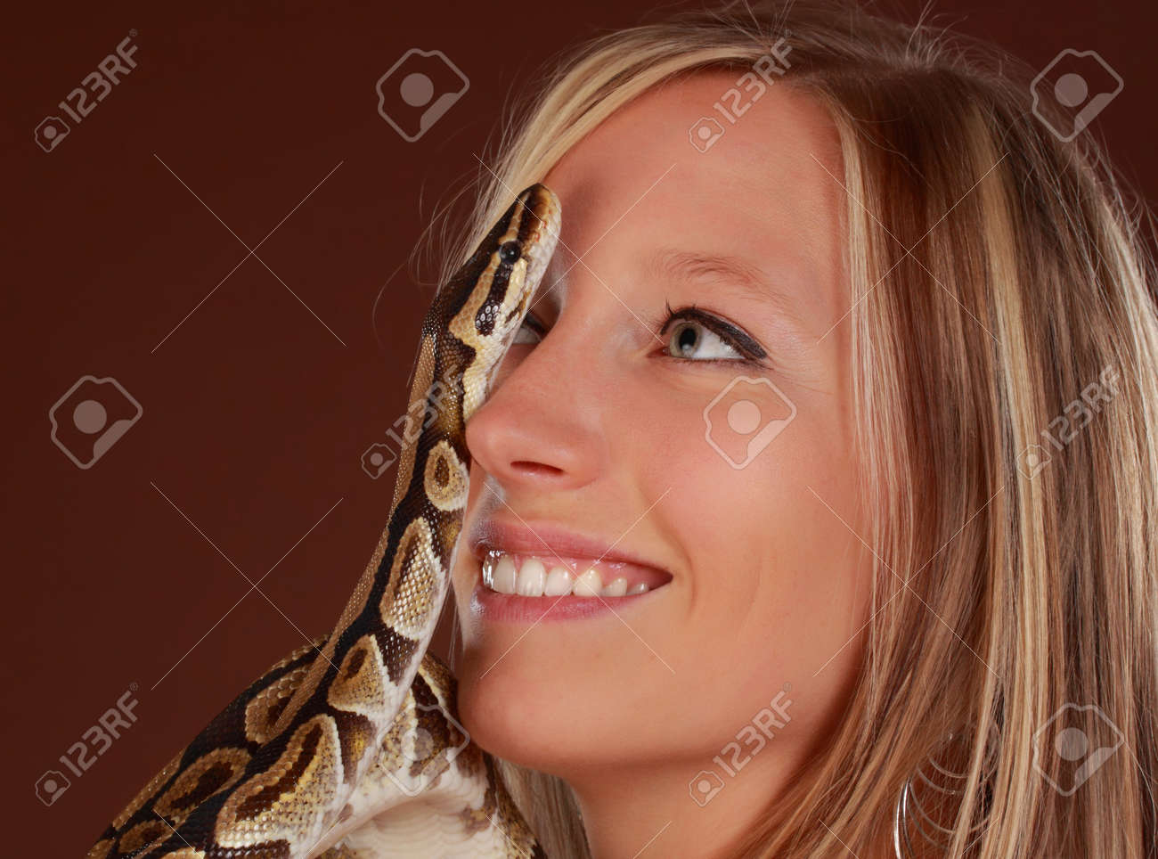 cute blond woman holding a Royal Python snake Stock Photo - 7346083