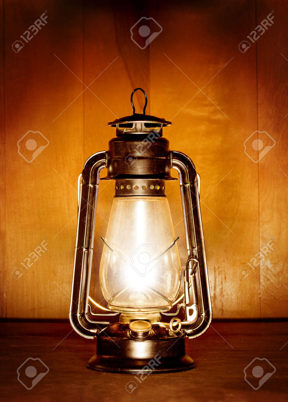 Old Oil Lamp Light Over Wood Plank Background Stock Photo, Picture ...