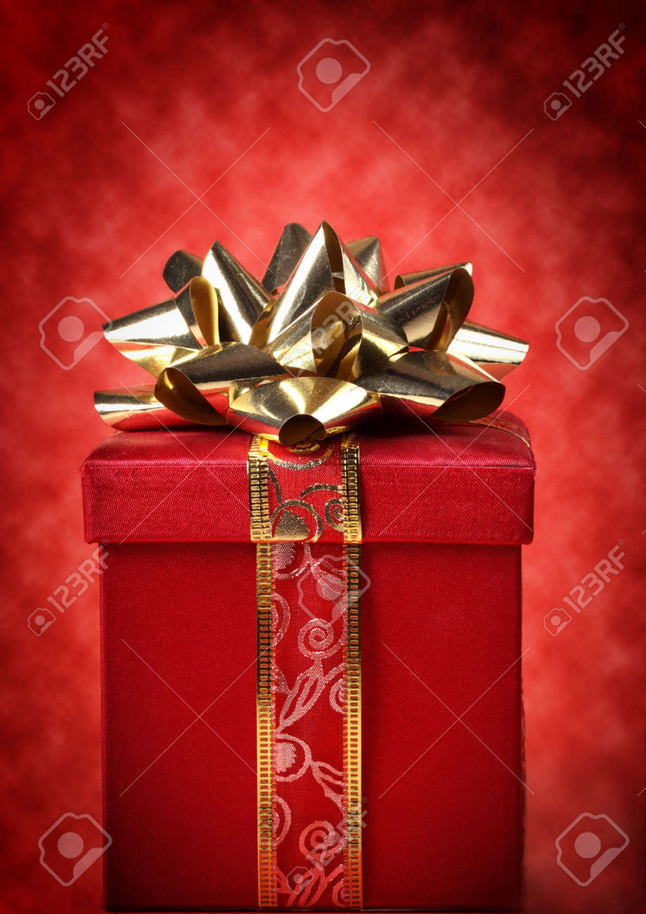 nice red and gold christmas gift, red background Stock Photo - 7918817