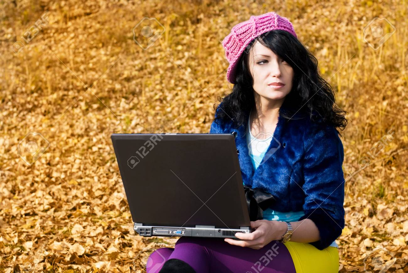 dreamy beautiful girl with a laptop outdoor Stock Photo - 3784070