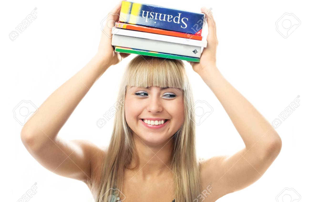 happy beautiful laughing blond girl with a lot of book on her head Stock Photo - 4259908