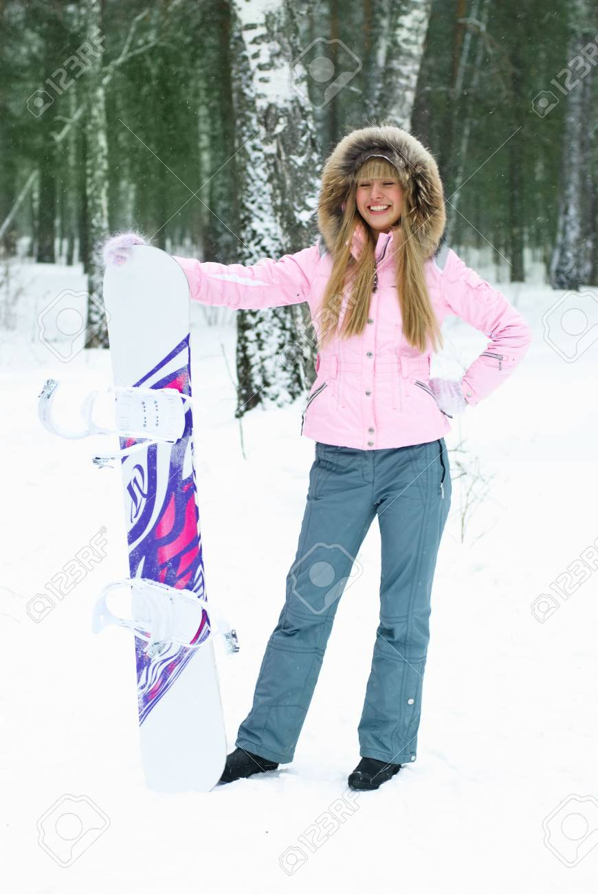 portrait beautiful happy young woman with a snowboard outdoor Stock Photo - 4300165