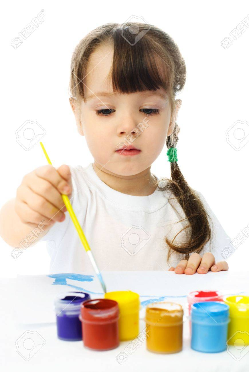 cute little girl sitting by the table and painting with watercolor Stock Photo - 4358354