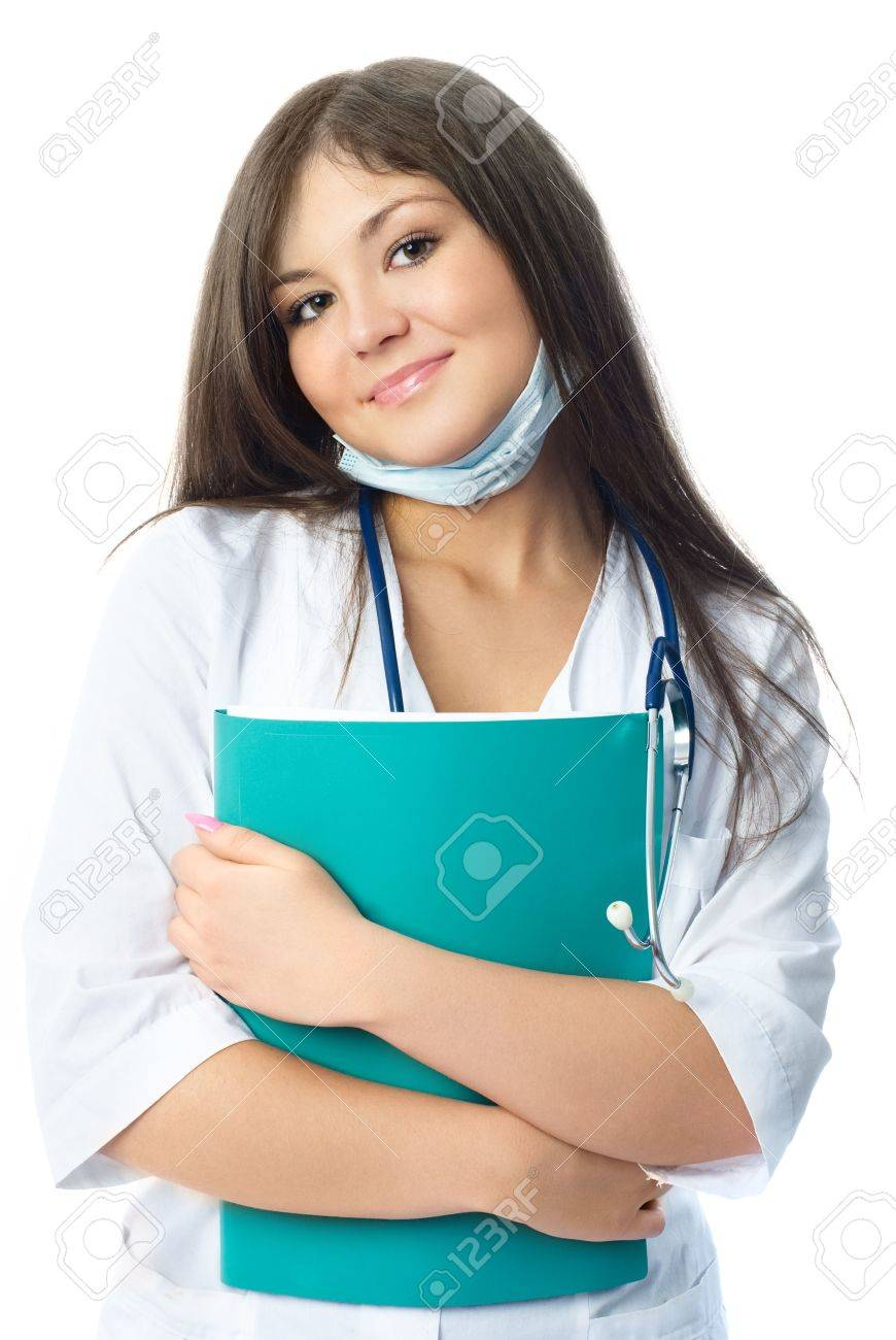 beautiful young doctor wearing white uniform and a protective mask and holding a green folder in her hands Stock Photo - 4520157