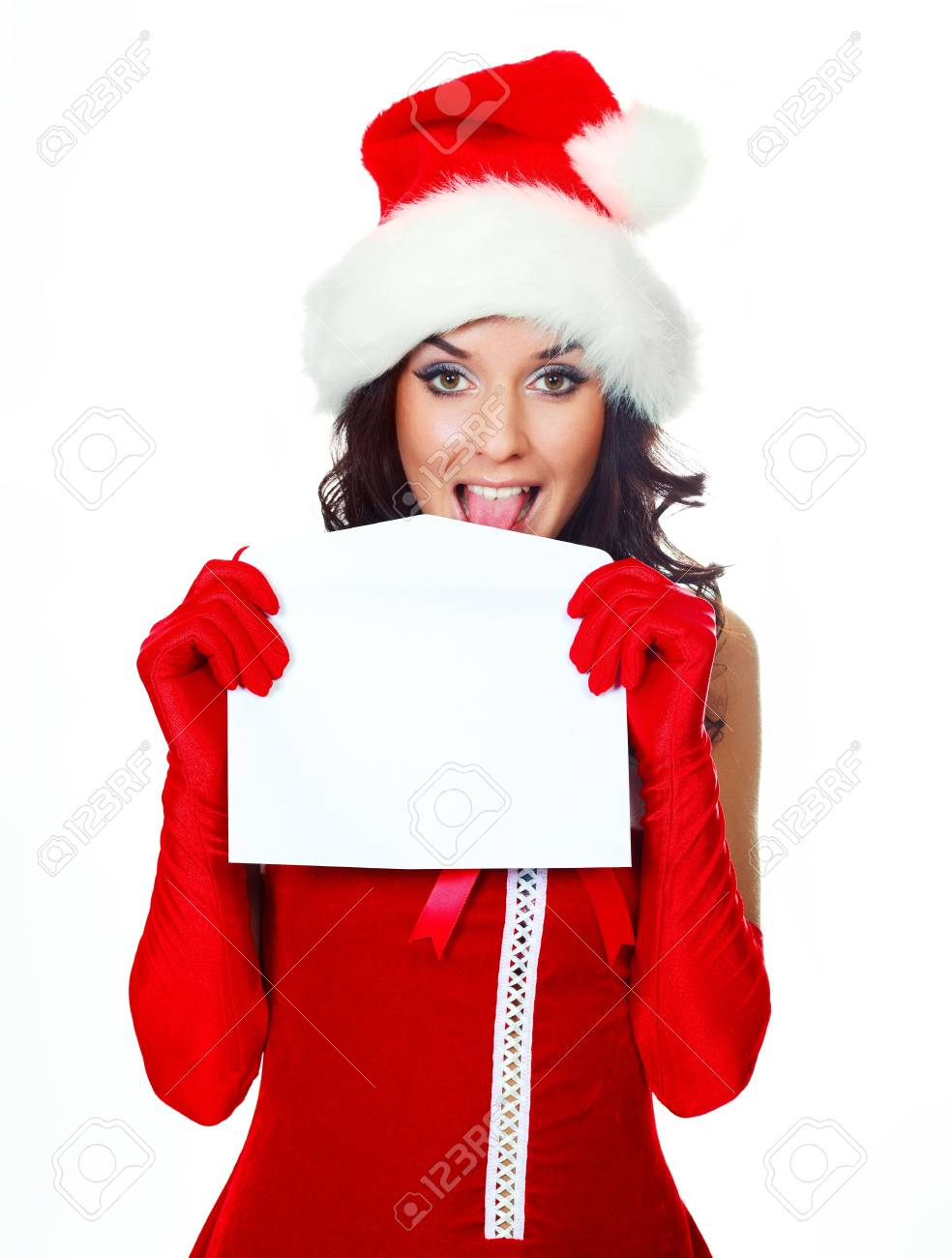 beautiful young brunette woman dressed as Santa licking an envelope to glue it Stock Photo - 5811640