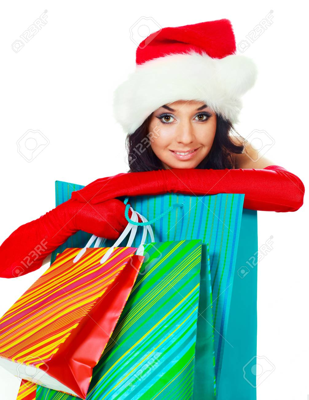 beautiful young brunette woman dressed as Santa with a lot of shopping bags Stock Photo - 5848910