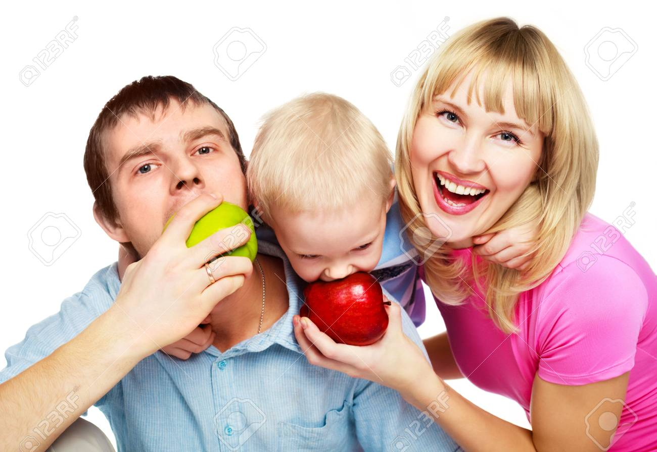happy young family eating apples, embracing and laughing Stock Photo - 6378175