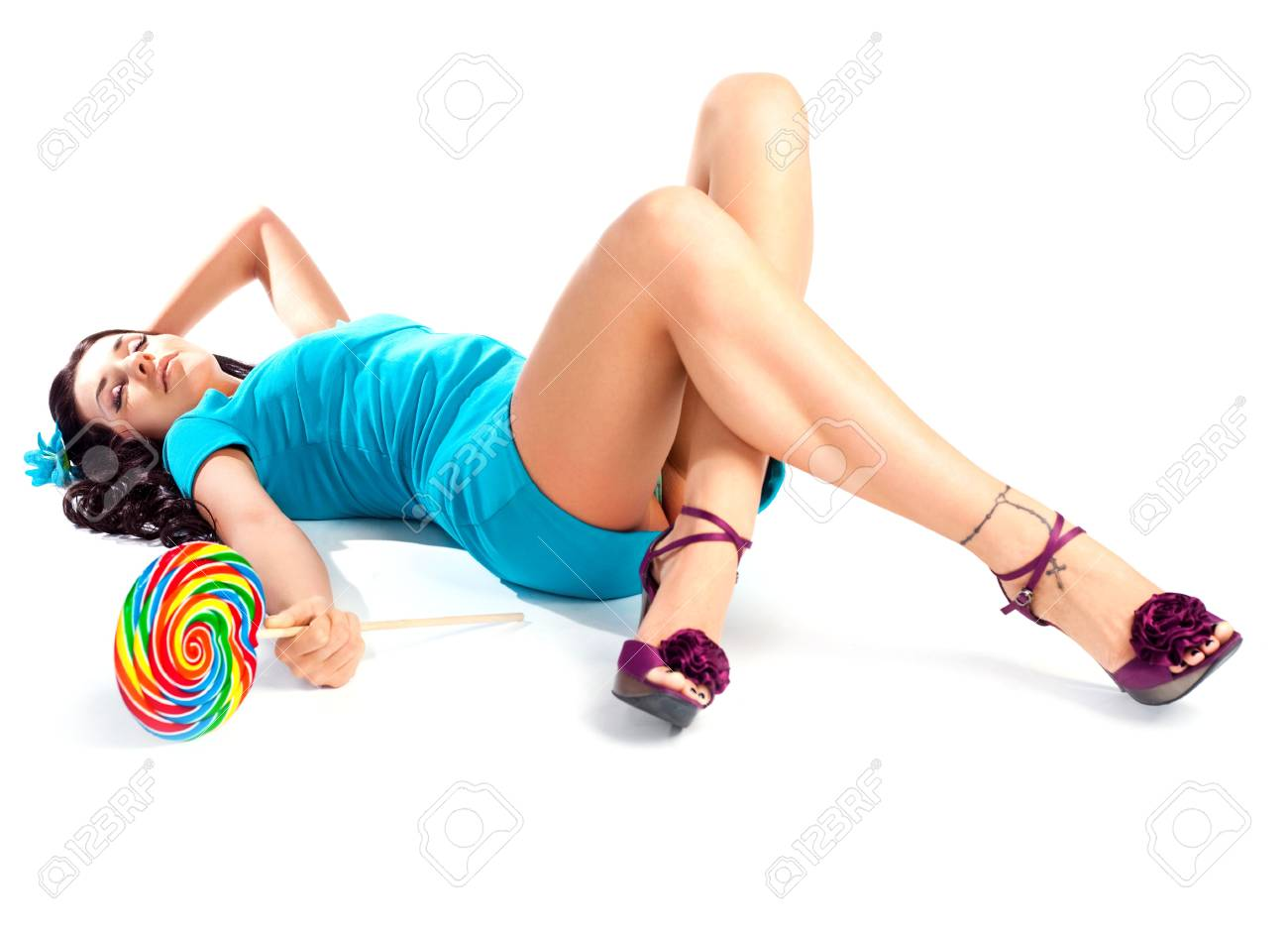 sexy  brunette girl with a lollipop in her hand Stock Photo - 7062321