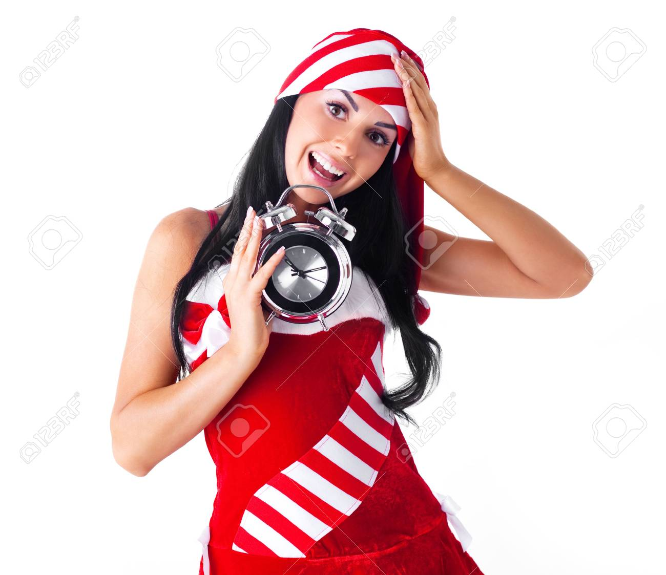 shocked young brunette woman dressed as Santa with an alarm clock Stock Photo - 7890395