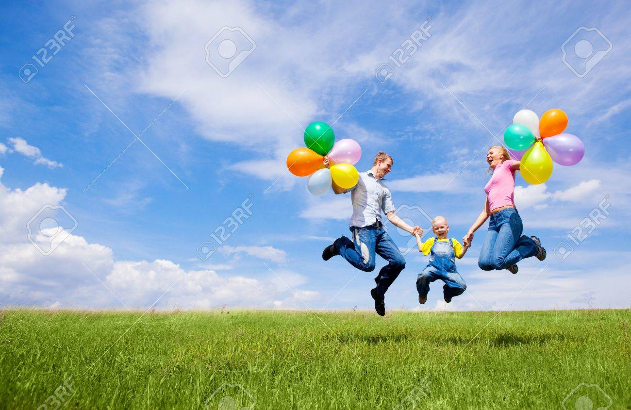 happy jumping family with balloons outdoor on a summer day Stock Photo - 8732703