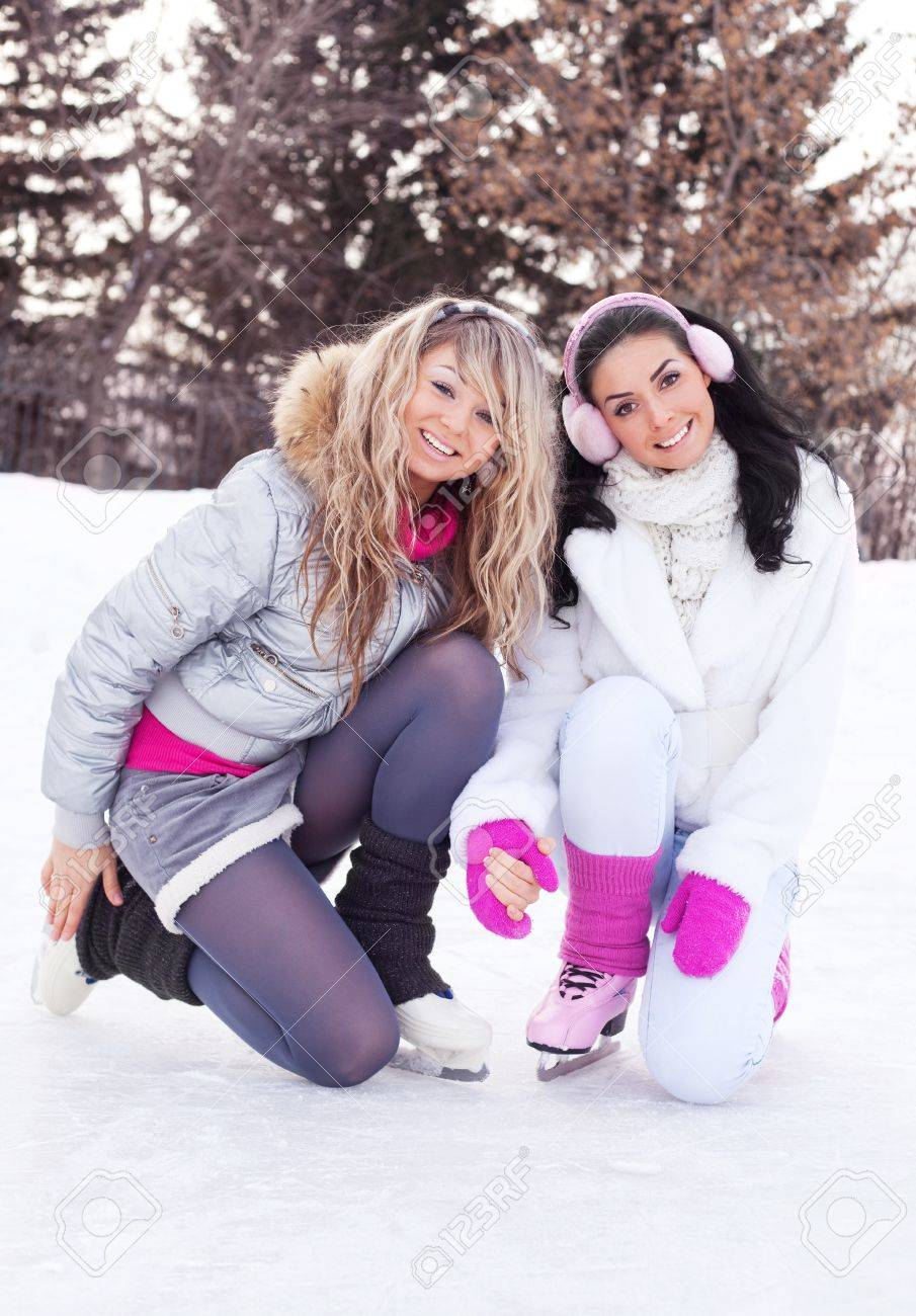 two beautiful girls ice skating outdoor on a warm winter day Stock Photo - 8942045