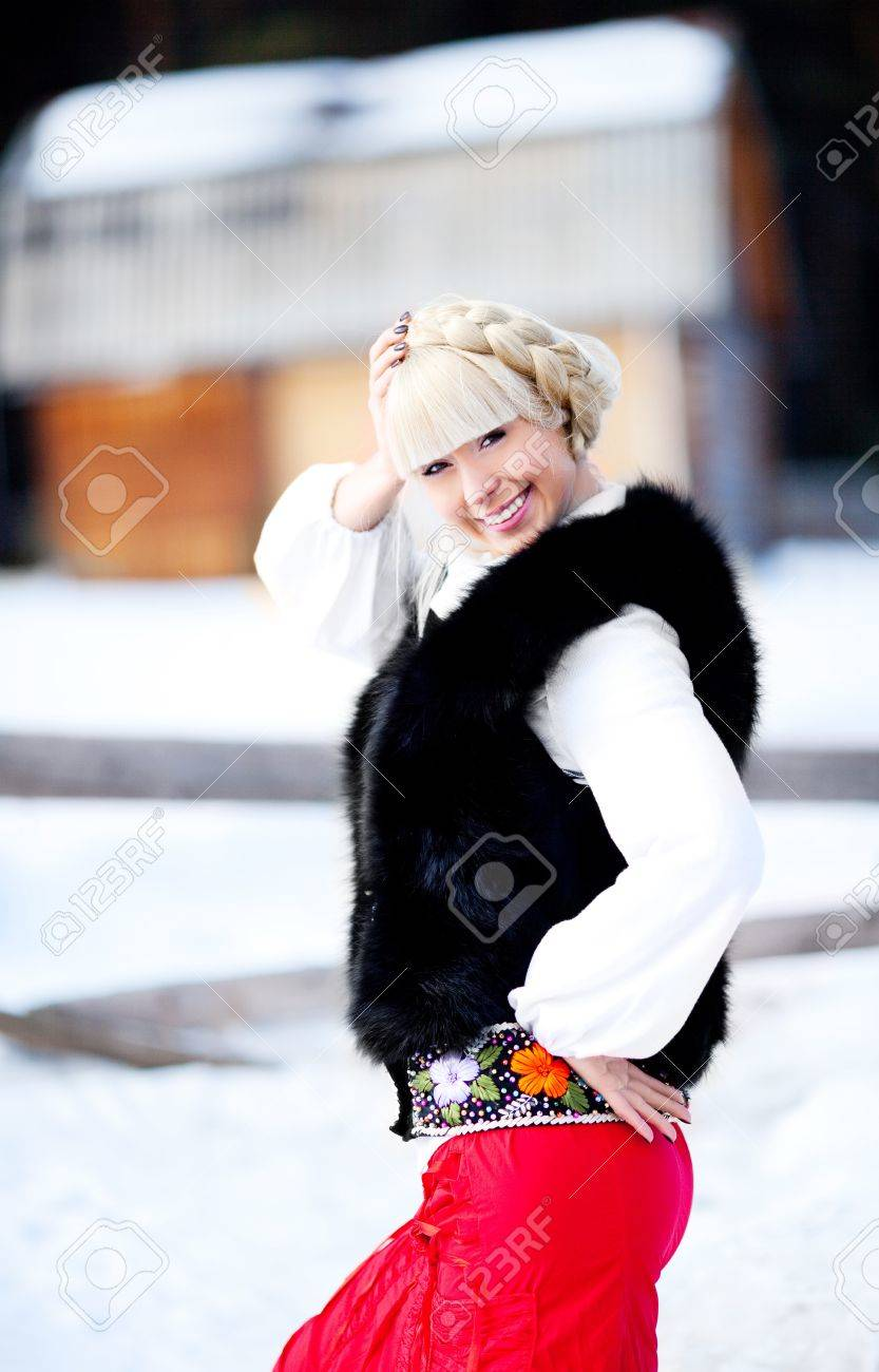 beautiful young blond Russian woman with a long plait Stock Photo - 9155190