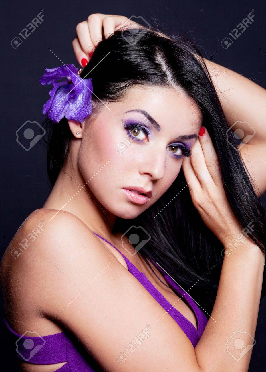 beautiful young brunette woman with  an orchid in her hair Stock Photo - 9315844
