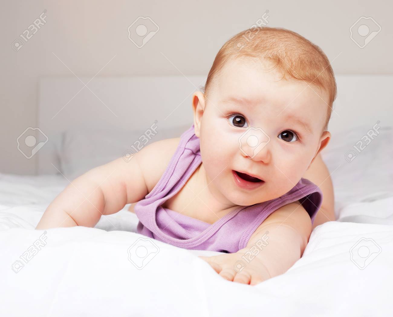 cute six months old baby on the bed at home Stock Photo - 9381363
