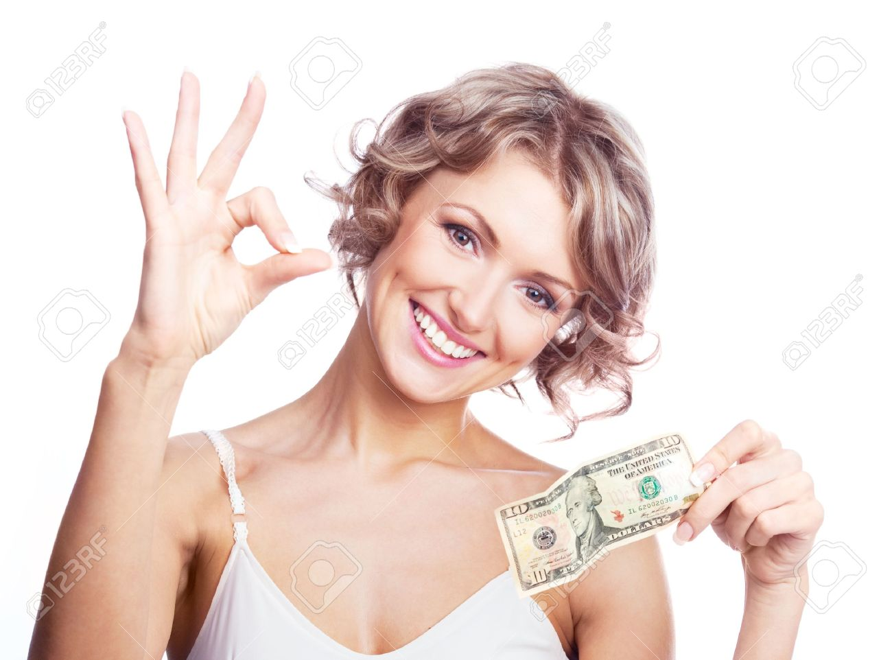 beautiful young  woman holding money and showing us the sign OK Stock Photo - 9394182
