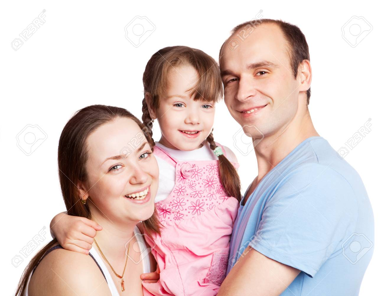 happy young family; mother, father and their daughter isolated against white background (focus on the woman) Stock Photo - 9757061