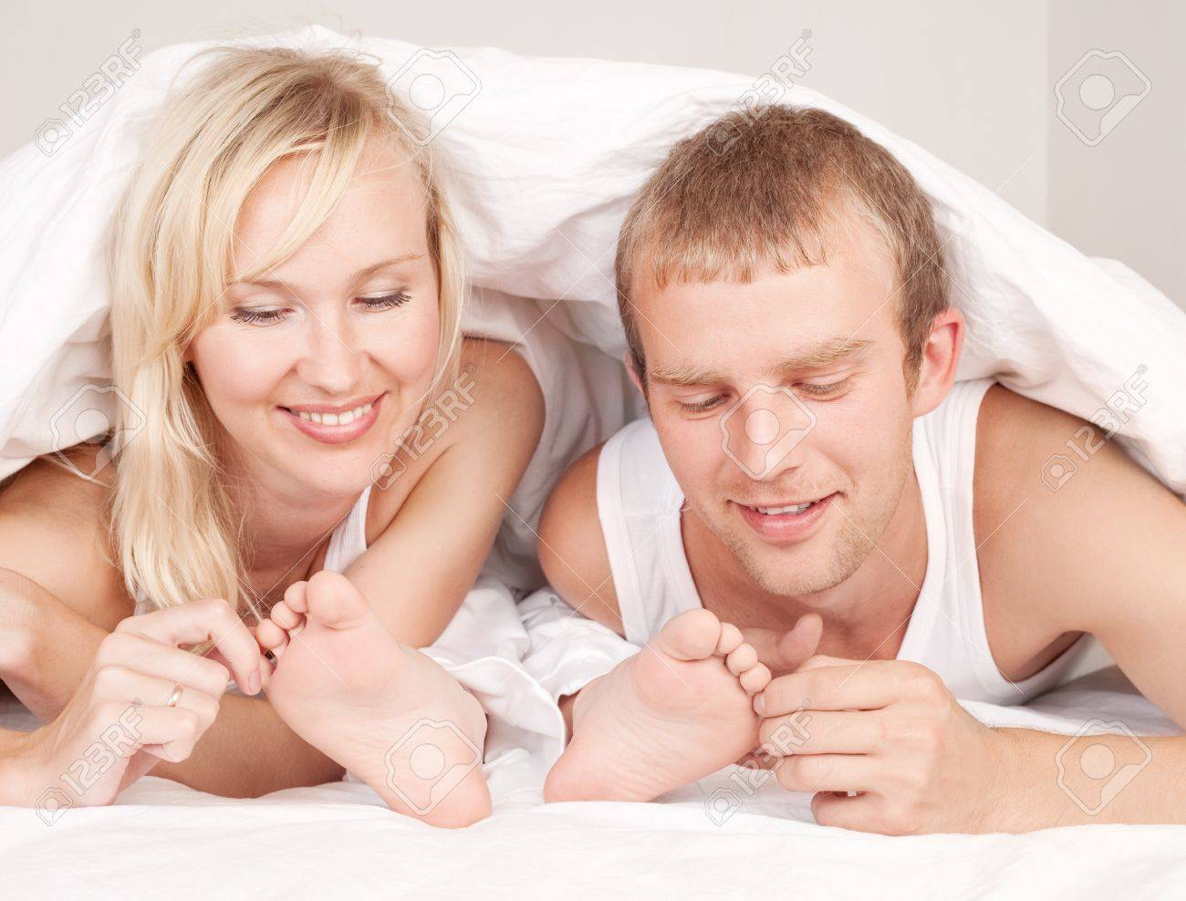 happy family; mother ,father and their son under the balnket in  bed at home Stock Photo - 10088330