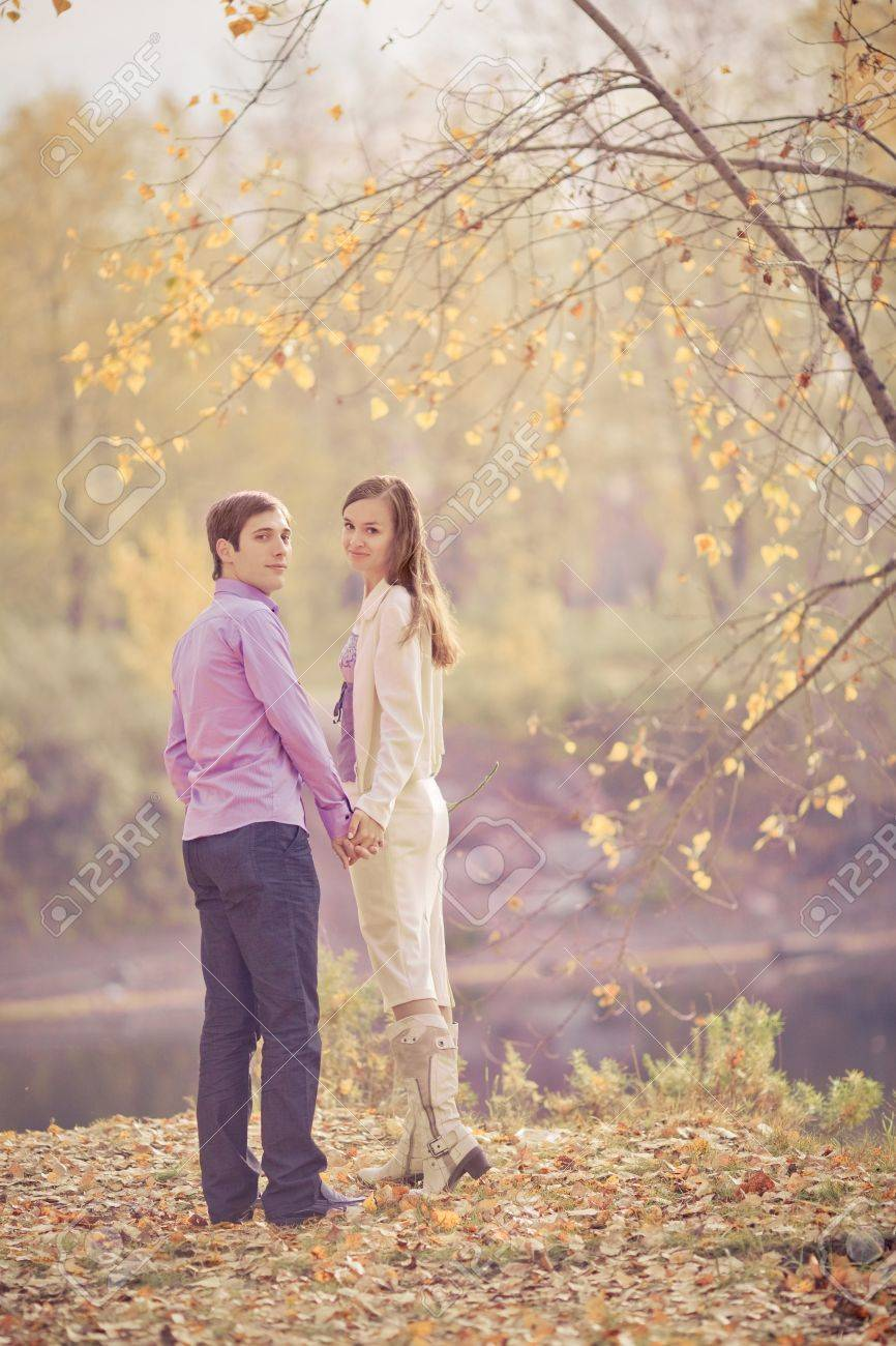 low contrast image of a happy young couple spending time outdoor in the autumn park Stock Photo - 10794770