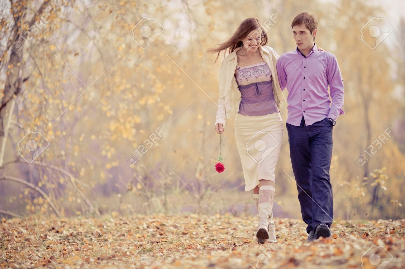 low contrast image of a happy romantic young couple spending time outdoor in the autumn park Stock Photo - 10794757